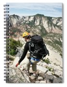 A Woman Cautiously Navigates A Steep Spiral Notebook