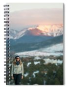 A Woman Stands Against A Snowy Mountain Spiral Notebook