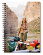 A Woman Unloads Gear From Her Canoe Spiral Notebook