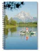 A Young Man Fly Fishes From His Drift Spiral Notebook