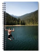 A Young Man Jumps From A Ledge Spiral Notebook