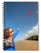 A Young Man Looks Up At His Red Kite Spiral Notebook
