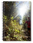 An Adult Woman Trail Running Spiral Notebook