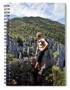 An Adventure Tourist Admires The Unique Spiral Notebook