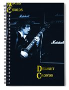 Angus Chords Delight Crowds In Blue Spiral Notebook