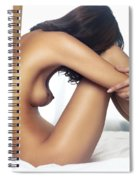 Beautiful Nude Woman Sitting On Bed With Arms Around Her Knees Spiral Notebook