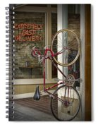 Bicycle Attached To Wall Outside Of Fast Food Restaurant Spiral Notebook