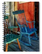 Blue Chair Against Red Door Spiral Notebook