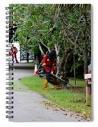 Camouflaged Leaf Blowers Working In Singapore Park Spiral Notebook