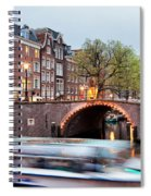 Canal Bridge And Boat Tour In Amsterdam At Evening Spiral Notebook