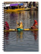 Cartoon - Ladies On A Wooden Boat On The Dal Lake With The Background Of Hoseboats Spiral Notebook