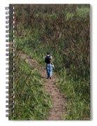 Cartoon - Man Walking Through Tall Grass In The Okhla Bird Sanctuary Spiral Notebook