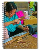 Child Watches As Mom Works In Teak Wood Carving Shop In Kanchanaburi-thailand Spiral Notebook