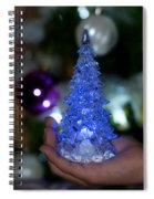 A Christmas Crystal Tree In Blue Spiral Notebook