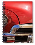 Close Up Of A Red Chevrolet Spiral Notebook