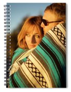 Couple Wraps Themselves In A Blue Spiral Notebook