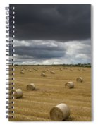Dark Storm Clouds Over A Field With Hay Spiral Notebook