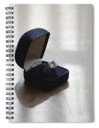 Diamond Ring On A Black Box Spiral Notebook