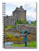 Eilean Donan Castle And The Lone Piper Spiral Notebook
