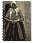 Elderly Woman In Black And White Spiral Notebook