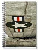 Emblem Underneath Spiral Notebook