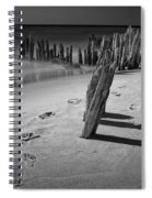 Footprints In The Sand Among The Pilings Spiral Notebook