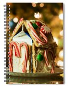 Gingerbread House Against A Background Of Christmas Tree Lights Spiral Notebook