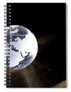 Glass Globe On Wooden Floor Spiral Notebook