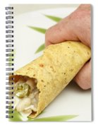 Hand Holding A Burrito Spiral Notebook
