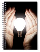 Hands Holding Light Bulb Spiral Notebook
