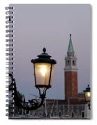 Lampposts Lit Up At Dusk With Building Spiral Notebook