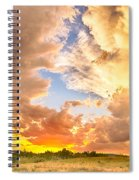 Looking Through The Colorful Sunset To Blue Spiral Notebook