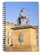 Low Angle View Of Statues In Front Of A Spiral Notebook