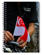 Man Plants Singapore Flag On Bicycle Spiral Notebook