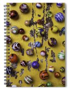 Marbles On Yellow Wooden Table Spiral Notebook