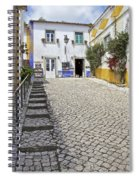 Medieval Cobblestone Street In The Fortified Walled European Village Of Obidos Spiral Notebook