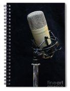 Microphone On Black Spiral Notebook