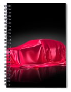 New Car Model Under Red Covering Spiral Notebook
