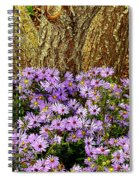 Purple Flowers At Base Of Tree Spiral Notebook