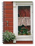 Red Wooden House With Plants In And By Spiral Notebook