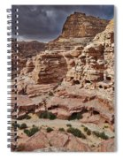 rock landscape with simple tombs in Petra Spiral Notebook