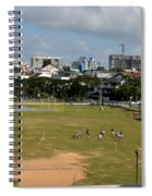 Schoolchildren Practicing On Playing Field With Singapore Skyline In Background Spiral Notebook