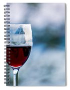 Single Glass Of Red Wine On Blue And White Background Spiral Notebook