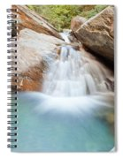 Small Waterfall Casdcading Over Rocks In Blue Pond Spiral Notebook