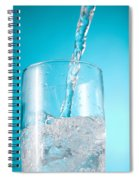 Stream Of Water Being Poured Into A Spiral Notebook