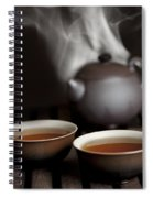 Tea In Cups With A Steaming Pot In The Spiral Notebook