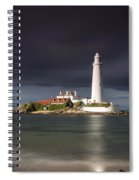 White Lighthouse Illuminated By Spiral Notebook