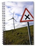 Wind Turbines On The Edge Of A Field With A Road Sign In Foreground. Spiral Notebook