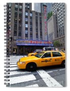 Yellow Cabs Pass In Front Of Radio City Music Hall Spiral Notebook