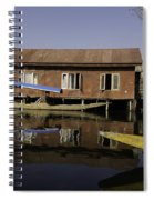 Yellow Shikara In Front Of A Run Down Area Of Houses In The Dal Lake Spiral Notebook